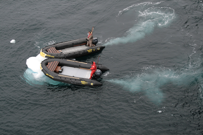 Zodiac semi-inflatables, here seen pushing small icebergs away from the (comparatively delicate) tender embarkation platform that hugs the side of the ship at the waterline (2007).