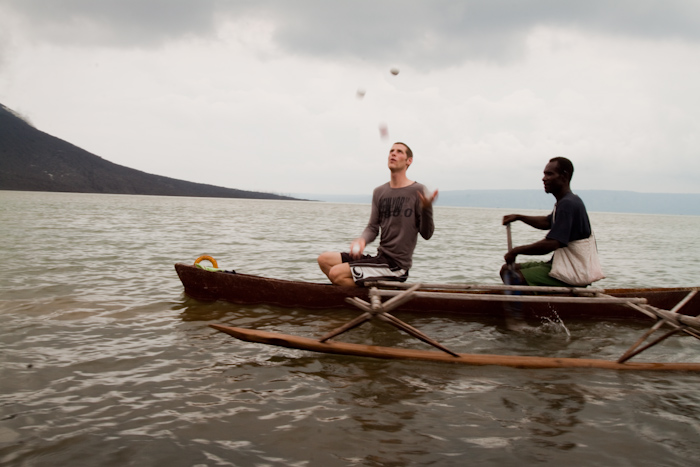 Me juggling in a local's canoe.