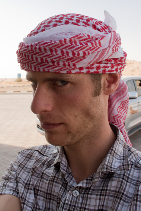 We drove out to the desert, stopping on the way a few times to buy drinks, food (I bought a Kinder Egg as it was Easter Sunday), and tourist trap tat. This is me after someone tried to convince me to buy a head scarf by actually wrapping it round my head.