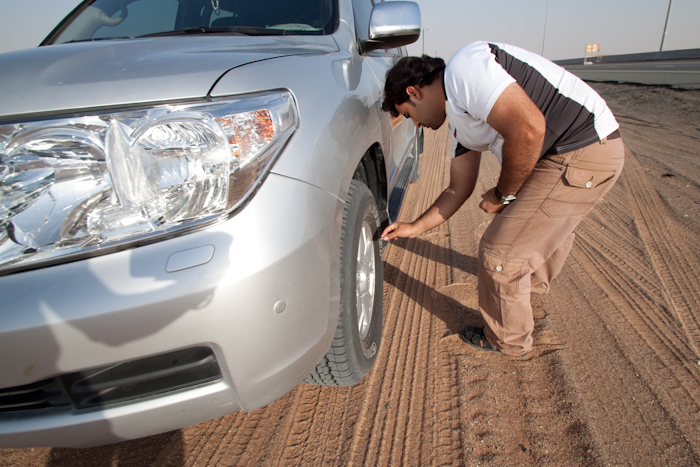 At the entrance to the dune area of the desert, our driver let loads of air out of each tire. More surface area = more grip on sand.