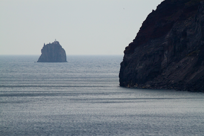 Looking past the edge of Stromboli to the weird shaped island rock of Strombolicchio.