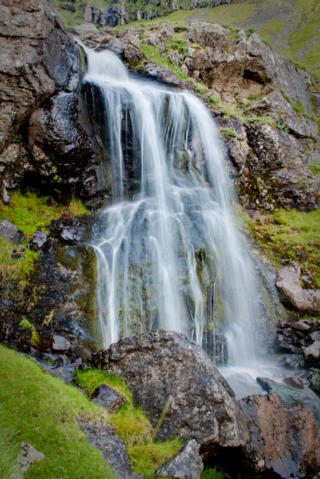 A long exposure HDR shot of a small waterfall.