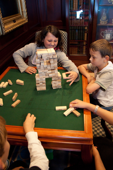 Kids on the ship playing their own version of Jenga.
