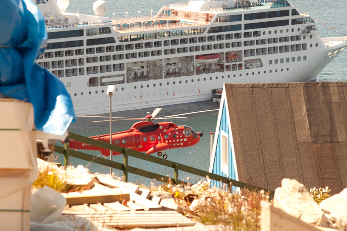 A helicopter flying past the Ocean Princess.