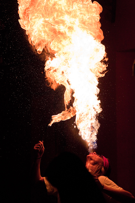 When I sat down to eat in, a fire breather started performing across the street. I've never taken photos of fire breathing before, and I didn't leave my table…