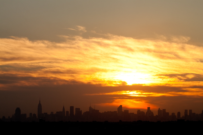 The sun setting over Queens and Manhattan, as seen from the top edge of the stadium.