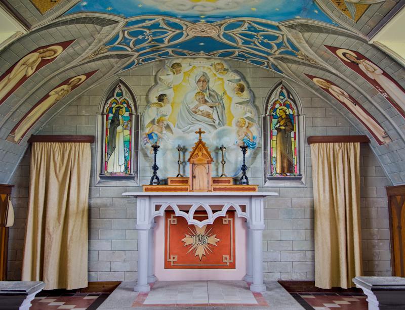 It's like a mini Sistine Chapel, all painted by Domenico Chiocchetti.