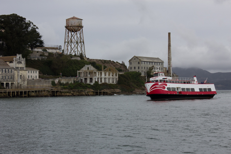 Alcatraz and a tourist boat. There were so many people on the sight seeing boat that when they all went to one side to look at Alcatraz, the boat tipped to starboard quite visibly. How many people on the catamaran? Five.