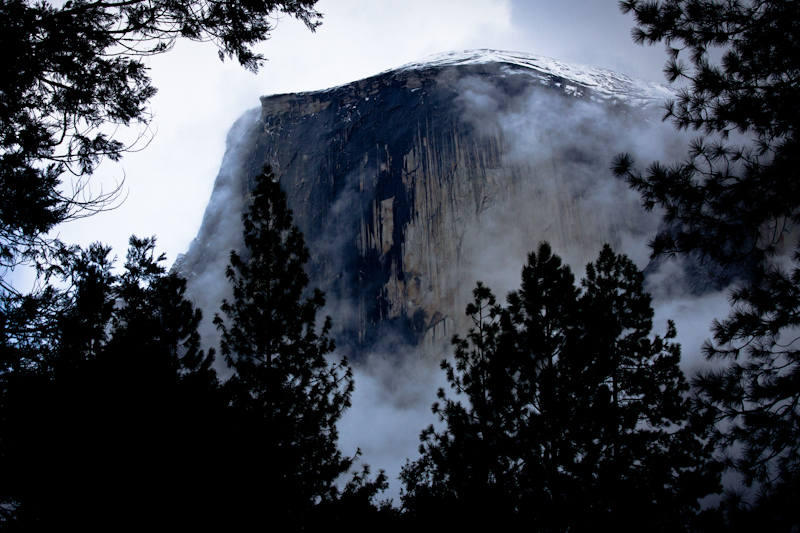 Half Dome peeks through the clouds and trees. This was my first glimpse of the rock.