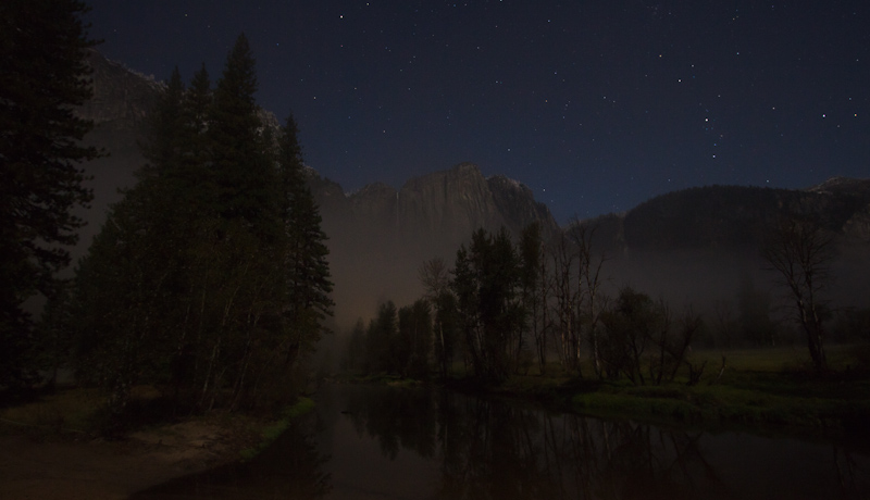 A view of the Yosemite Falls from the Swinging Bridge, as lit by star and moonlight.