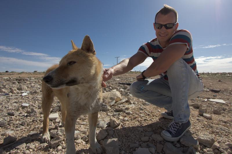 Petra, Jordan: Steve making a friend during a rest stop on the bus trip.