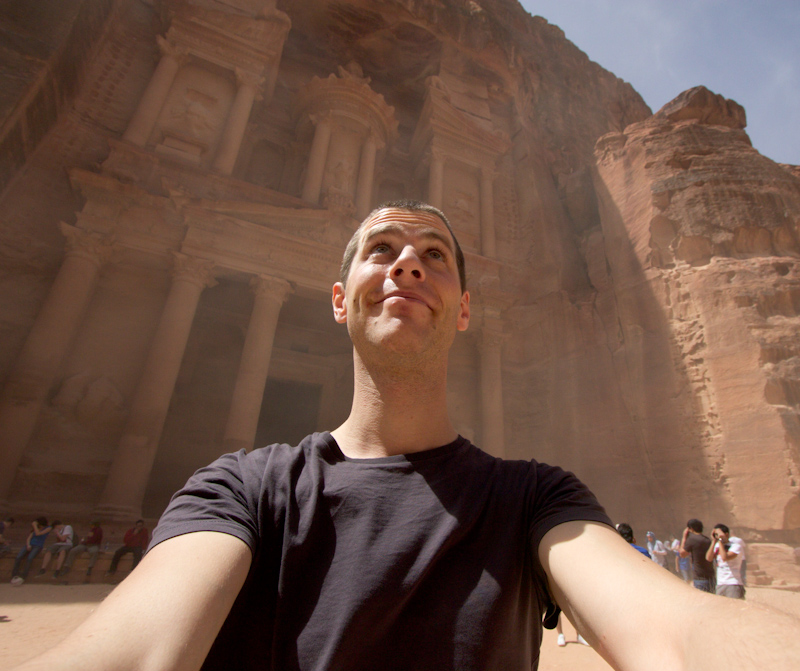Petra, Jordan: The Treasury and me, doing my best to ignore the sand blasting in my face.