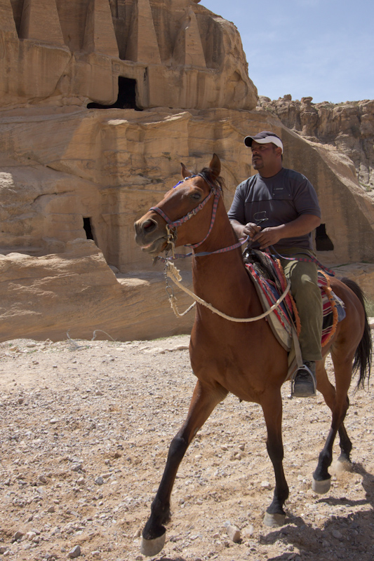 Petra, Jordan: Horse riding past the Obelisk tomb.