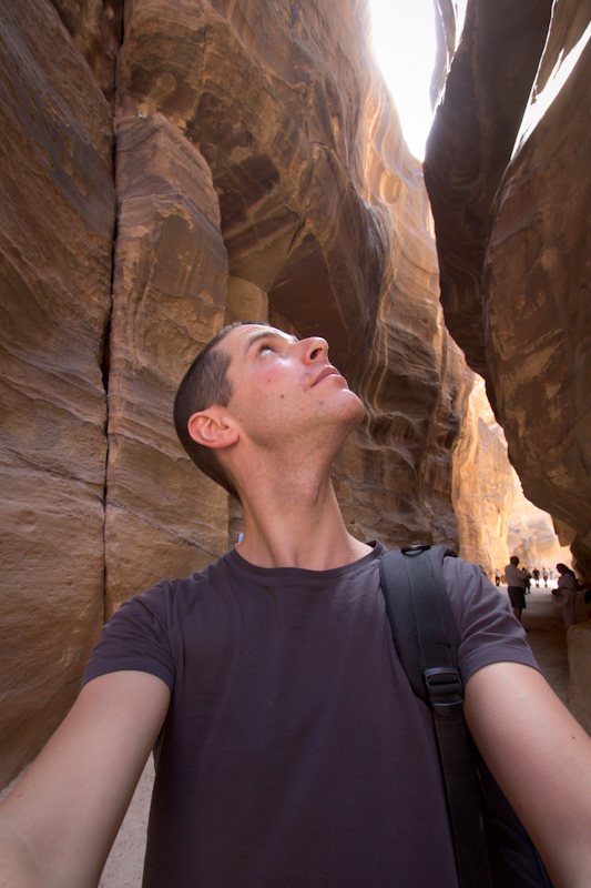 Petra, Jordan: Me looking up at the very narrow gorge.